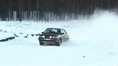Winter rally car passing by DNxHD Stock Footage