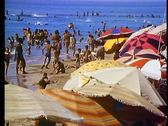 Stock Video Footage of Alexandria, beach, people and beach umbrellas, medium shot