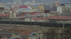Long goods train traveling on railway at Taian City near Mountain Tai,After rai Stock Footage
