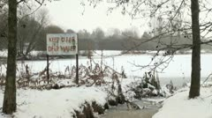 Warning Sign of Deep Water Sign by Frozen Lake Stock Footage