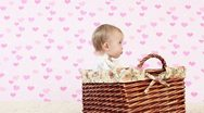 Stock Video Footage of Laughing baby in a wicker basket