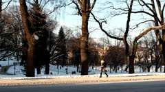 People walking by in park DNxHD Stock Footage