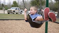 Boy on a swing Stock Footage