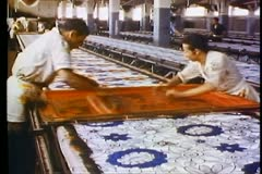 Cotton factory, silk screening, two men, medium shot, passing brush across Stock Footage