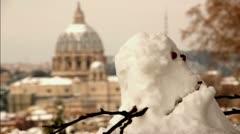 Child kills snowman near St. Peter's - Rome Stock Footage