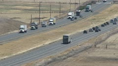 CA Central Valley I-5 lots of trucks Stock Footage