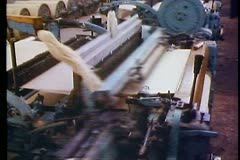 Cotton factory, looms weaving, long shot, fast, no people Stock Footage