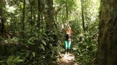 Swinging On Liane In Rainforest Stock Footage