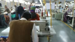 Workers Sewing at a Textile Factory in India Stock Footage