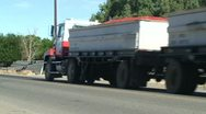 Stock Video Footage of CA Central Valley Water Pipes with Tomato Truck passing