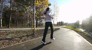 Girl runs through the park in the morning Stock Footage