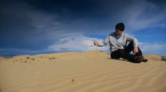 Man in the desert sand Stock Footage