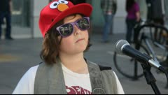 Editorial - Young guitar player playing rock music at Downtown Santa Monica - stock footage