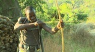 Man hunting with bow and arrow Stock Footage