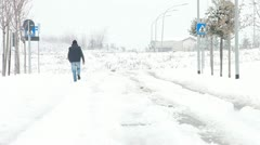 Man walking on the snow Stock Footage