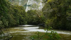 Pan of beautiful rain forest river and waterfall Stock Footage