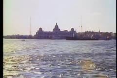 Port Said, wide shot, Suez Canal headquarters building, backlight, sea in front Stock Footage