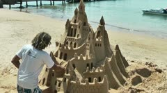 Artist making a sand castle on the beach Stock Footage