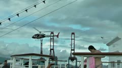 Police helicopter above cruise ship sailing from the port Stock Footage