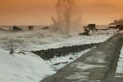 Waves Crashing Over Pier Stock Footage