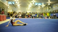 Stock Video Footage of Talented Level 10 Gymnast Performing Floor Exercise Routine During Competition