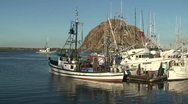 Stock Video Footage of CA Morro Bay Z-In to Salmon Boat moving through boats tied