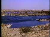 Stock Video Footage of The Nile, cataracts (rapids) the old dam distant, wide shot