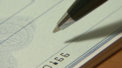 Writing Checks - stock footage