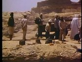 Stock Video Footage of Archeological site near pyramids, group working, hand trucks, medium shot