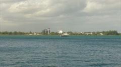 US Coast Guard Patrol Boat  - wind mills - electric power station harbor bay Stock Footage