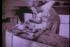Howard Carter working on the mummy's coffin ,B&W Photograph Stock Footage