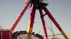 Slow motion of rotating carnival ride Stock Footage