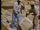 Stock Video Footage of Temples of Philae being rebuilt, two men pound block with sledgehammer
