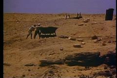 Archeological site near pyramids, group working, hand trucks, medium shot - stock footage