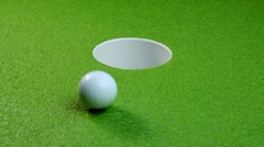 Golf balls miss the hole Stock Footage