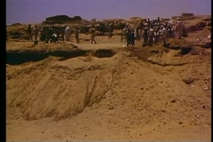 Egyptian archeology workers on a hill near Aswan 108410 Stock Footage