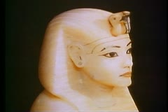 Stock Video Footage of The King Tut Treasures, a white alabaster bust of the Pharaoh 108427