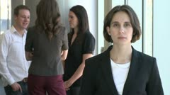 Office Female is pleased by the conversation of her team (2 of 2) - stock footage