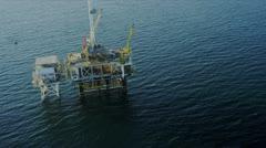 Aerial view of deep ocean oil platform, USA - stock footage