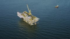 Aerial view of deep ocean oil platform, USA - stock footage