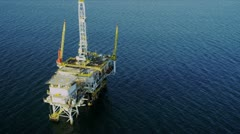 Stock Video Footage of Aerial view of oil rig deep ocean, USA