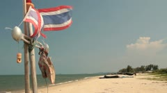 Thai fishing boat on beach 1 Stock Footage