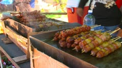 Street food in Panama - chorizo and potatoes on skewers, #1 Stock Footage