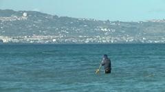 Fishing in cold Sea. Catania, La Plaja. Stock Footage
