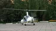 Stock Video Footage of Helicopter-plane on a site