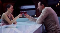 Young couple in love sitting at a bar counter with wine galsses HD Stock Footage