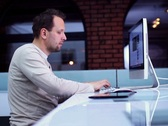 Young man surfing the net on computer in modern interior NTSC Stock Footage