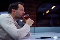 Sad lonely man drinking wine in bar NTSC Stock Footage