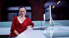 Happy woman surfing the net on computer in modern interior HD - stock footage