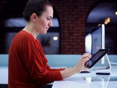 Woman surfing the net on tablet computer in modern interior NTSC Stock Footage
